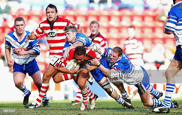 Adrian Lam of Wigan powers through Swinton tackles during the Powergen Challenge Cup Quarter Final match between Wigan Warriors and Swinton Lions at...