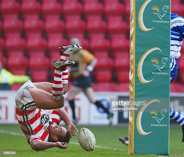 Adrian Lam of Wigan Warriors scores a try whilst doing a forward roll during the Powergen Challenge Cup QuarterFinals match between Wigan Warriors...