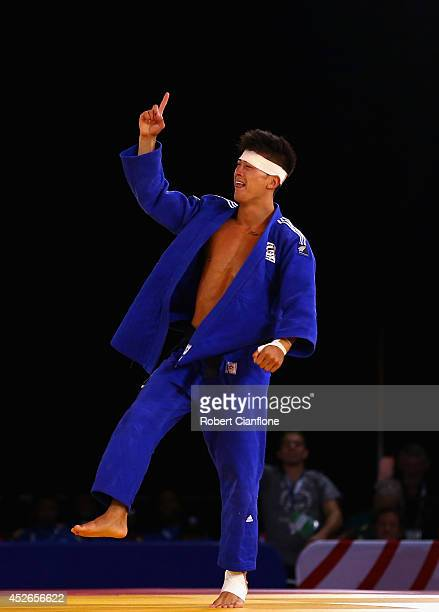 Adrian Leat of New Zealand celebrates after defeating Emmanuel Nartey of Ghana in the Men's Judo 73kg at SECC Precinct during day two of the Glasgow...