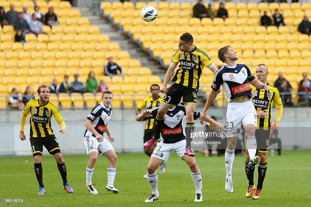 Adrian Leijer of the Victory and Corey Gameiro of the Phoenix compete for a header during the round 27 A-League match between the Wellington Phoenix the Melbourne Victory at Westpac Stadium on March 31, 2013 in Wellington, New Zealand.