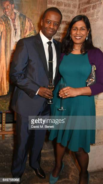 Adrian Lester and Lolita Chakrabarti attend the St MartinintheFields Gala Dinner and auction of Alexander Newley portraits on March 8 2017 in London...