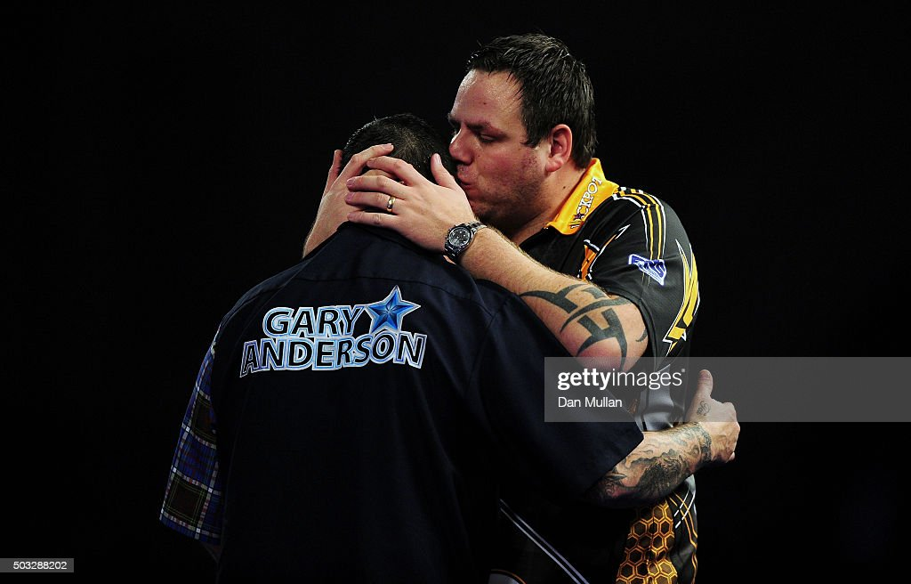 Adrian Lewis of England (r) embraces Gary Anderson of Scotland after being defeated in the final match during Day Fifteen of the 2016 William Hill PDC World Darts Championships at Alexandra Palace on January 3, 2016 in London, England.