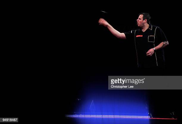 Adrian Lewis of England in action against Aodhagan O'Neill of Republic of Ireland during the 2010 Ladbrokescom World Darts Championship Round One at...