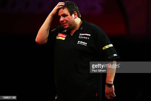 Adrian Lewis of England looks dejected after losing the quarter final match between Adrian Lewis of England and Michael Van Gerwen of Netherlands on...