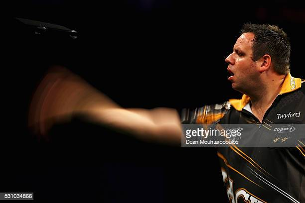 Adrian Lewis of England plays a shot in his match against Gary Anderson of Scotland during the Darts Betway Premier League Night 15 at Rotterdam Ahoy...