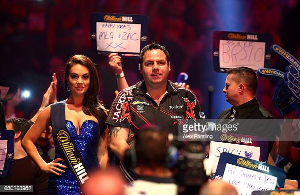 Adrian Lewis of England walks on prior to his first round match against Magnus Caris of Sweden during day five of the 2017 William Hill PDC Darts...