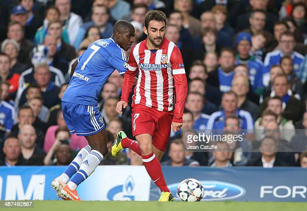 Adrian Lopez Alvarez of Atletico Madrid in action is watched by Ramires of Chelsea during the UEFA Champions League semi final second leg match...