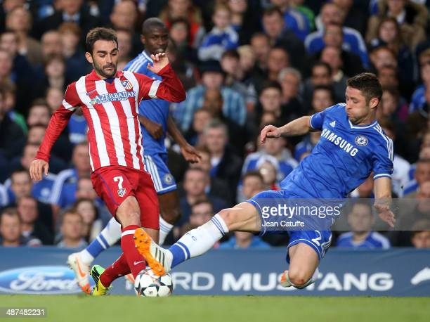 Adrian Lopez Alvarez of Atletico Madrid is tackled by Gary Cahill of Chelsea during the UEFA Champions League semi final second leg match between...