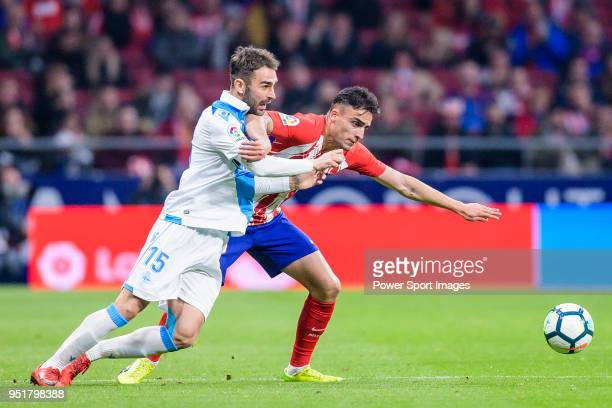 Adrian Lopez Alvarez of Deportivo La Coruna fights for the ball with Carlos Isaac of Atletico de Madrid during the La Liga 201718 match between...