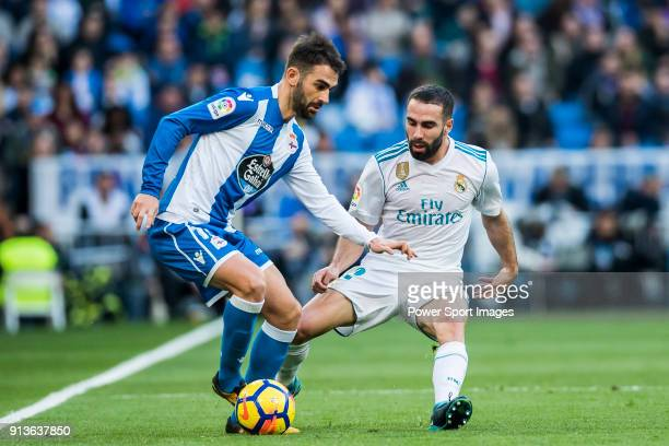 Adrian Lopez Alvarez of RC Deportivo La Coruna battles for the ball with Daniel Carvajal Ramos of Real Madrid during the La Liga 201718 match between...