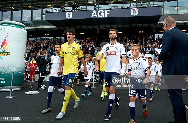 Adrian Lopez of AGF Aarhus and Christian Norgaard of Brondby IF walks on to the pitch prior to the Danish Alka Superliga match between AGF Aarhus and...