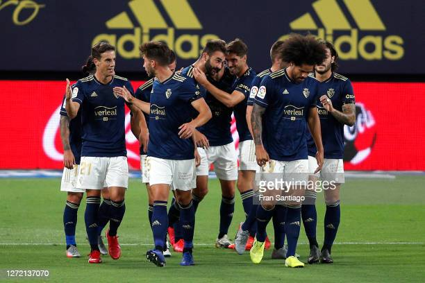 Adrian Lopez of CA Osasuna celebrates with his team mates after scoring his team's first goal during the La Liga match between Cadiz and Osasuna at...