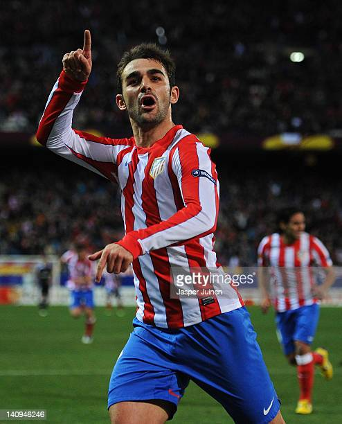Adrian Lopez of Club Atletico de Madrid celebrates scoring his sides third goal during the UEFA Europa League round of 16 first leg match between...