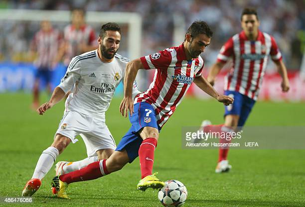 Adrian Lopez of Club Atletico de Madrid is closed down by Dani Carvajal of Real Madrid during the UEFA Champions League Final between Real Madrid CF...