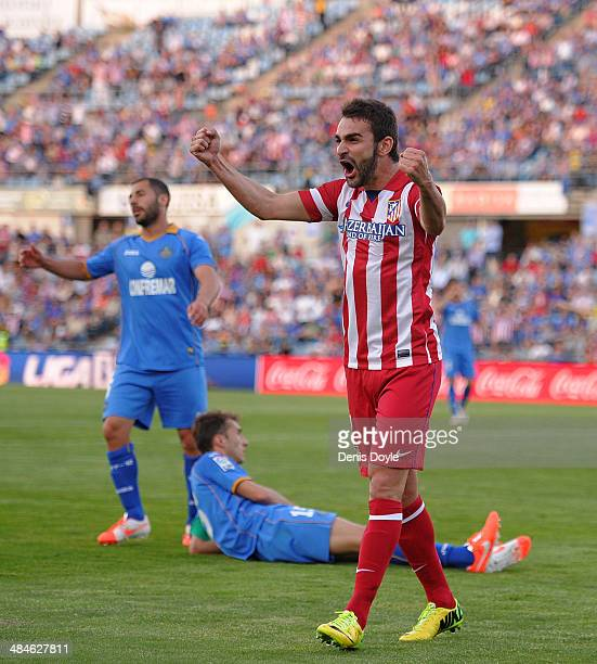 Adrian Lopez of Club Atletico de Madrid reacts after teammate Diego Costa scored Atletico's 2nd goal during the La Liga match between Getafe CF and...
