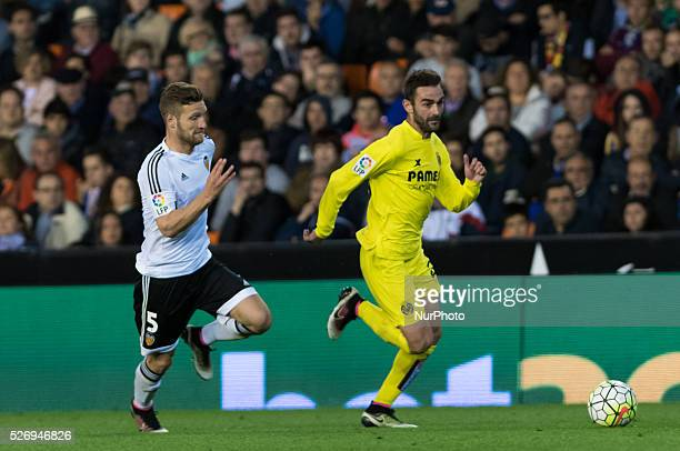 Adrian Lopez of Villarreal CF and Shkordan Mustafi of Valencia during the Spanish League Match match at Estadio Mestalla Valencia on 1May of 2016