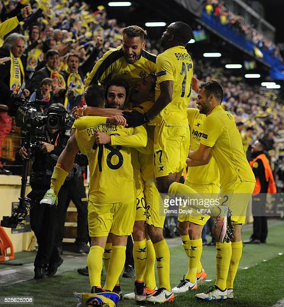Adrian Lopez of Villarreal CF celebrates with teammates after scoring his team's opening goal during the Europa League Semi Final first leg match...