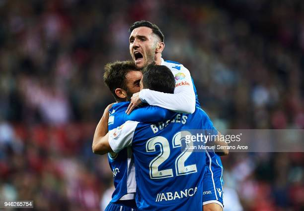 Adrian Lopezof RC Deportivo La Coruna celebrates with his teammates Celso Borges and Lucas Perez of RC Deportivo La Coruna after scoring his team's...
