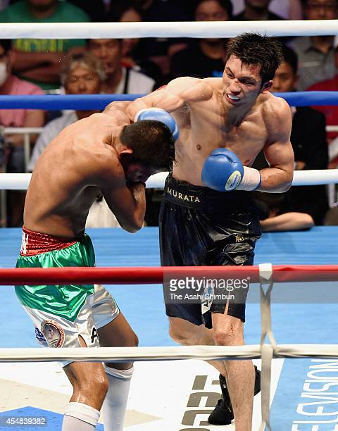 Adrian Luna Flores of Mexico and Ryota Murata of Japan exchange punches in the tenth round during their nontitle bout at Yoyogi Daini National...