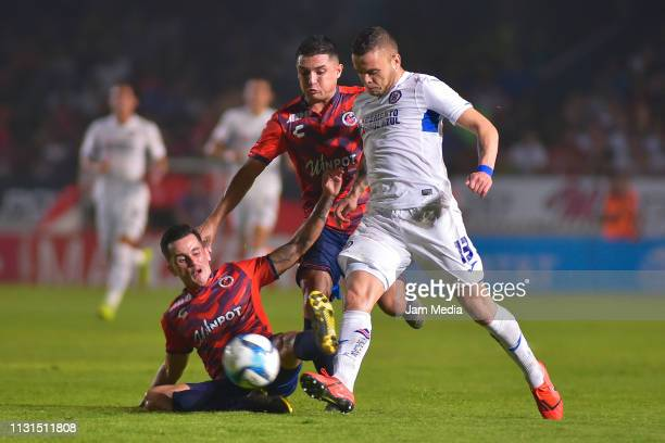 Adrian Luna of Veracruz and Jesus Paganoni of Veracruz fight for the ball with Jonathan Rodriguez del Cruz Azul during the 8th round match between...