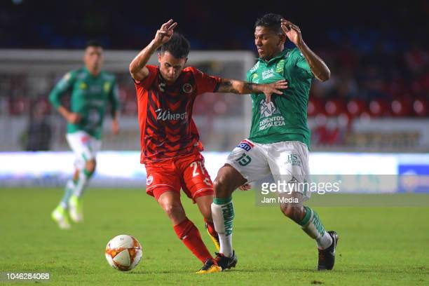 Adrian Luna of Veracruz fights for the ball with Alexander Mejia of Leon during the 11th round match between Veracruz and Leon as part of the Torneo...