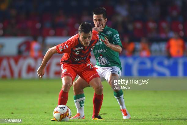Adrian Luna of Veracruz fights for the ball with Fernando Navarro of Leon during the 11th round match between Veracruz and Leon as part of the Torneo...