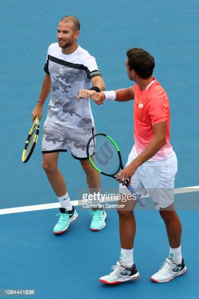 Adrian Mannarino of France and Andreas Mies of Germany during their second round doubles match against Bob Bryan and Mike Bryan of the United States...