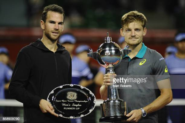 Adrian Mannarino of France and David Goffin of Belgium pose during the trophy presentation after Goffin defeated Mannarino in the men's final match...