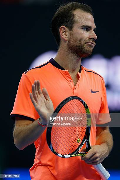 Adrian Mannarino of France applause Rafael Naldal of Spain during the Men's singles third round match on day six of the 2016 China Open at the China...