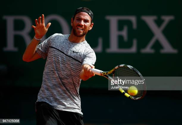 Adrian Mannarino of France hits a forehand return during his Mens Singles match against Gilles Simon of France at MonteCarlo Sporting Club on April...