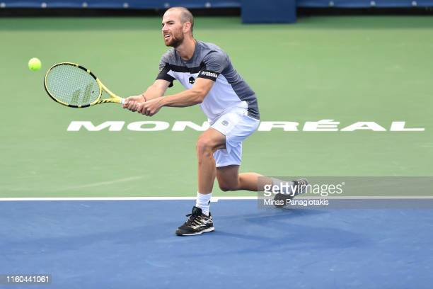 Adrian Mannarino of France hits a return against Fabio Fognini of Italy during day 7 of the Rogers Cup at IGA Stadium on August 8 2019 in Montreal...