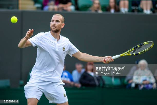 July 02: Adrian Mannarino of France in action against Marin Cilic of Croatia on Court Three during the Wimbledon Lawn Tennis Championships at the All...