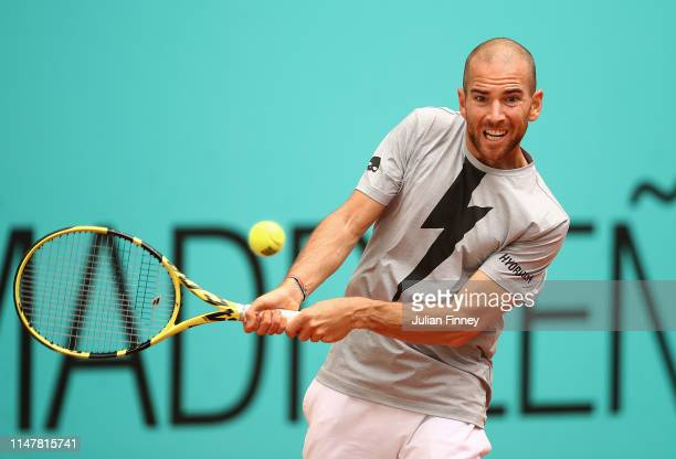 Adrian Mannarino of France in action against Stefanos Tsitsipas of Greece during day five of the Mutua Madrid Open at La Caja Magica on May 08 2019...