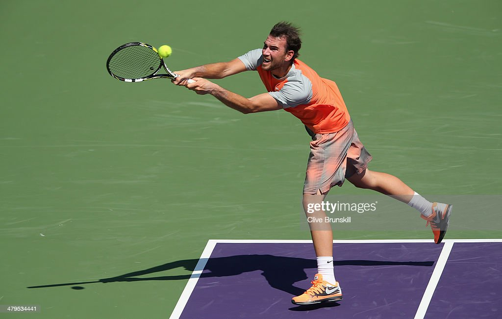 Adrian Mannarino of France plays a backhand against Nikolay Davydenko of Russia during their first round match during day 3 at the Sony Open at Crandon Park Tennis Center on March 19, 2014 in Key Biscayne, Florida.
