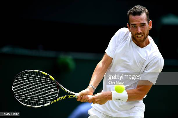 Adrian Mannarino of France plays a backhand against Roger Federer of Switzerland during their Men's Singles fourth round match on day seven of the...