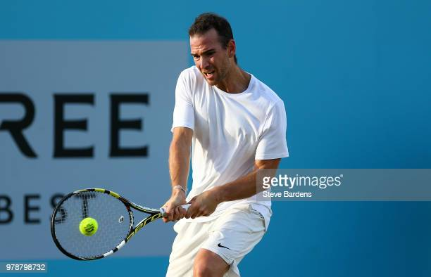 Adrian Mannarino of France plays a backhand during his match against Dan Evans of Great Britain on Day Two of the FeverTree Championships at Queens...
