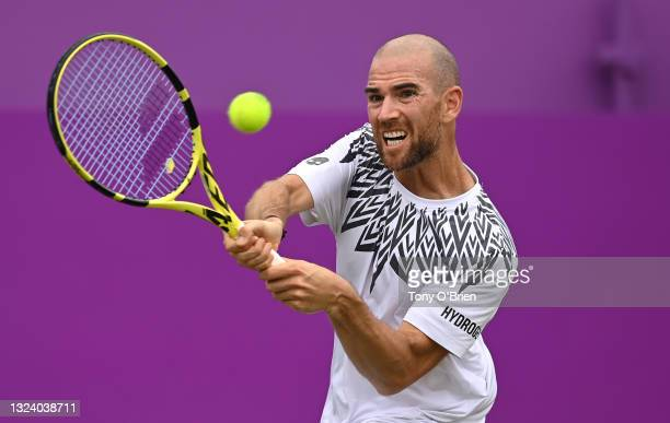 Adrian Mannarino of France plays a backhand during his Round of 16 match against Daniel Evans of Great Britain during Day 4 of The cinch...