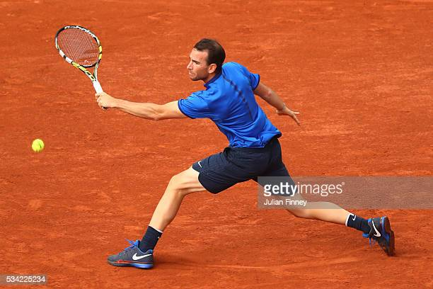 Adrian Mannarino of France plays a backhand during the Men's Singles second round match against Milos Raonic of Canada on day four of the 2016 French...