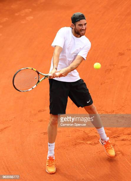 Adrian Mannarino of France plays a backhand during the mens singles first round match against Steve Johnson of The United States during day three of...