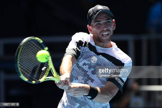 Adrian Mannarino of France plays a backhand in his first round match against Kevin Anderson of South Africa during day one of the 2019 Australian...
