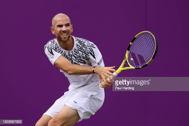 Adrian Mannarino of France plays a backhand in his First Round match against Liam Broady of Great Britain during Day 1 of the cinch Championships at...