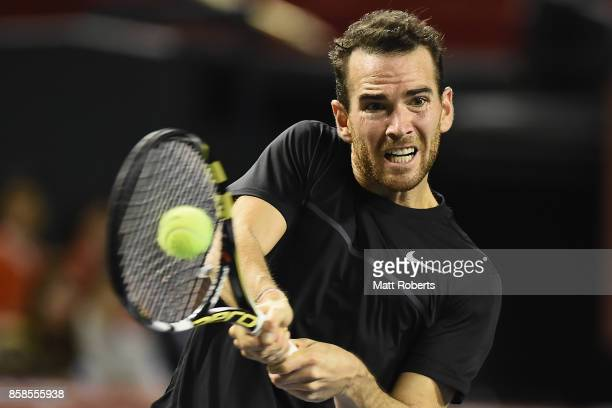 Adrian Mannarino of France plays a backhand in his semi final match against Marin Cilic of Coratia during day six of the Rakuten Open at Ariake...
