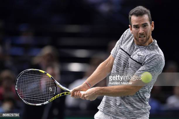 Adrian Mannarino of France plays a backhand in the men's single first round match against David Ferrer of Spain during day two of the Rolex Paris...