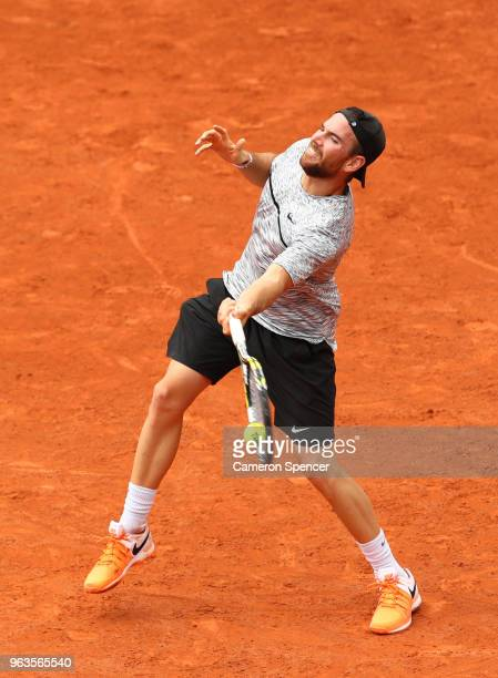 Adrian Mannarino of France plays a forehand during his mens singles first round match against Steve Johnson of The United States during day three of...