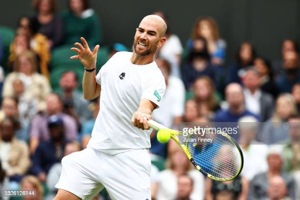 Adrian Mannarino of France plays a forehand in his Men's Singles First Round match against Roger Federer of Switzerland during Day Two of The...