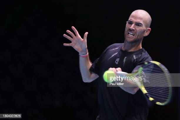 Adrian Mannarino of France plays a forehand in his Men's Singles second round match against Roberto Marcora of Italy on day four of the Singapore...