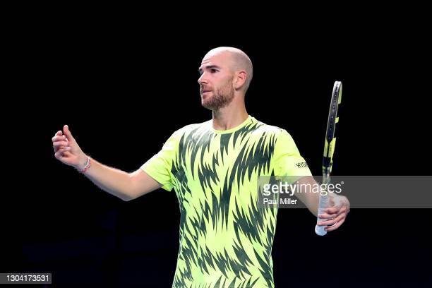 Adrian Mannarino of France reacts in his Men's Singles Quarterfinals match against Radu Albot of Moldova on day five of the Singapore Tennis Open at...