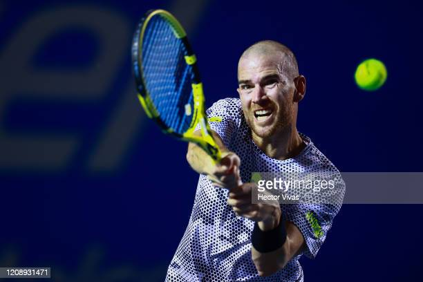 Adrian Mannarino of France returns a ball during the singles match between Adrian Mannarino of France and Grigor Dimitrov of Bulgaria as part of the...