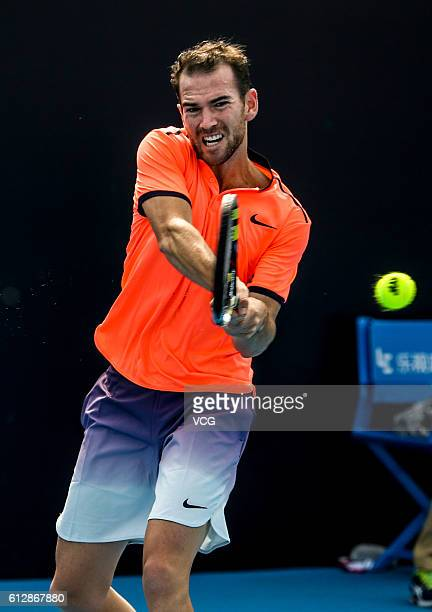 Adrian Mannarino of France returns a shot against Albert RamosVinolas of Spain during the Men's singles first round match on day five of the 2016...