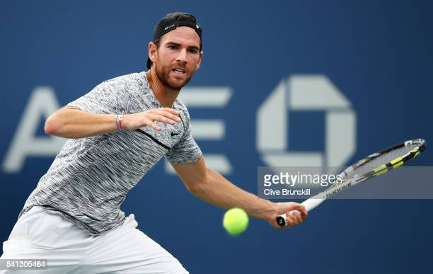 Adrian Mannarino of France returns a shot against Bjorn Fratangelo of the United States during their second round Men's Singles match on Day Four of...